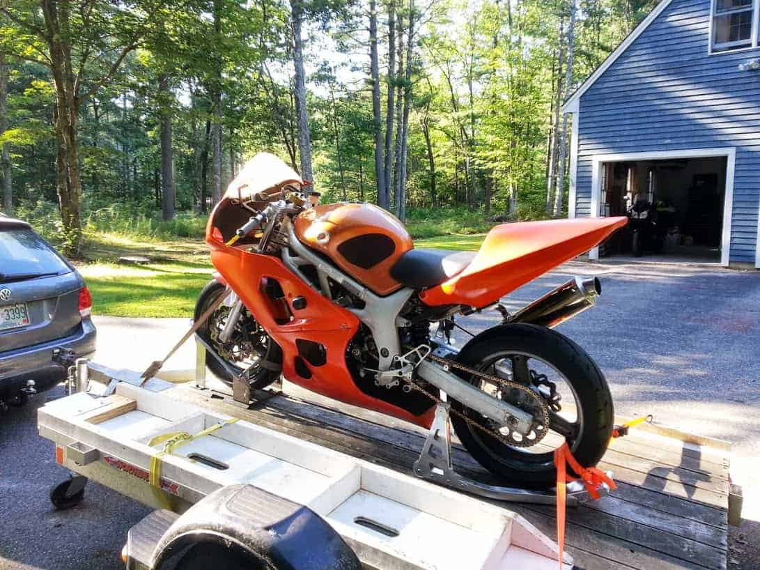 Motorcycle transported in a trailer with a wheel chock Image
