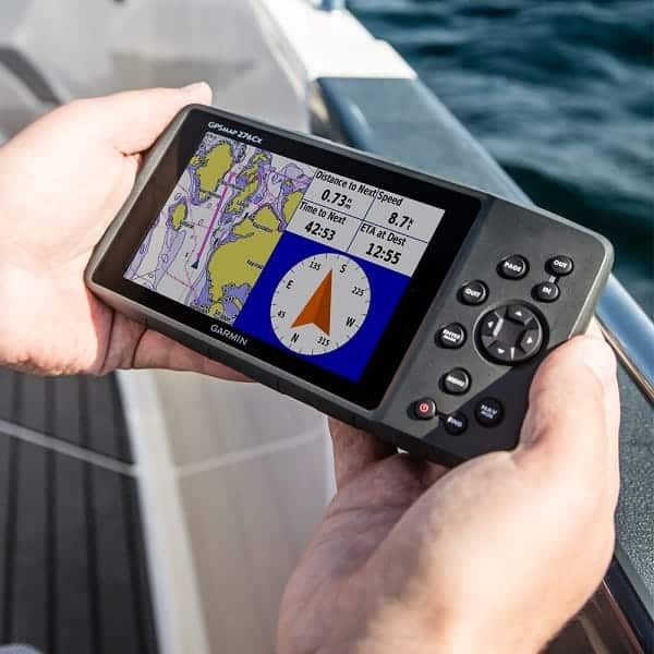 Image of a man holding a marine chartplotter