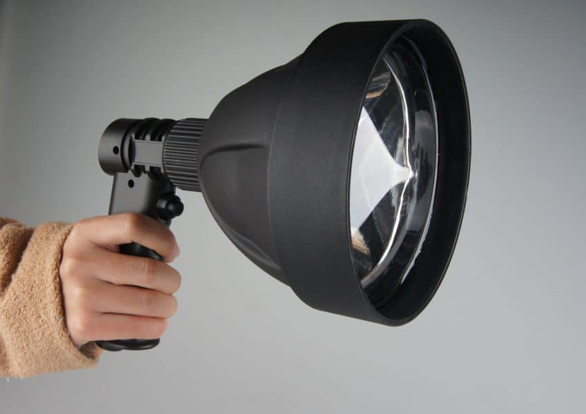 Image of a woman holding a spotlight