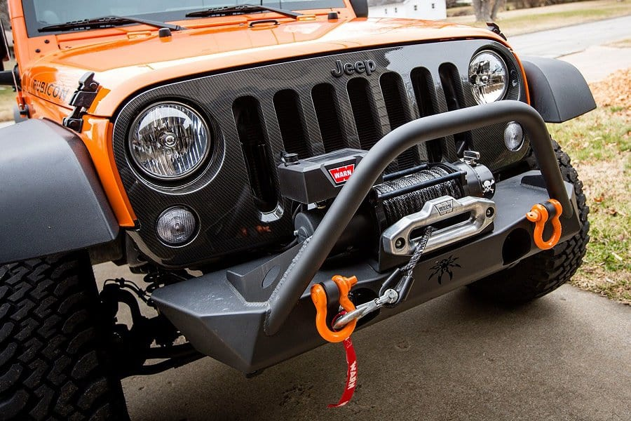 Picture of the front end of a Jeep that has a winch installed