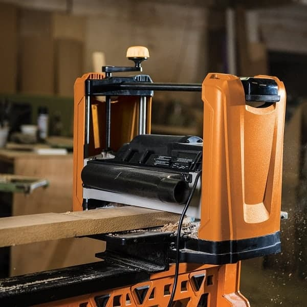 Image of a benchtop planer being used