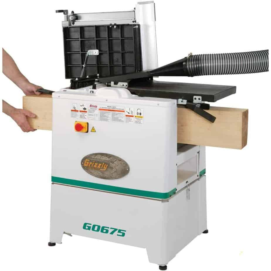 Man using a jointer planer combo machine Image