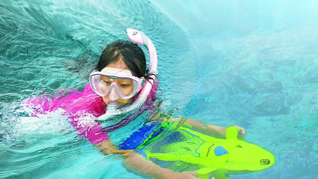 Image of a girl using the underwater scooter in the pool